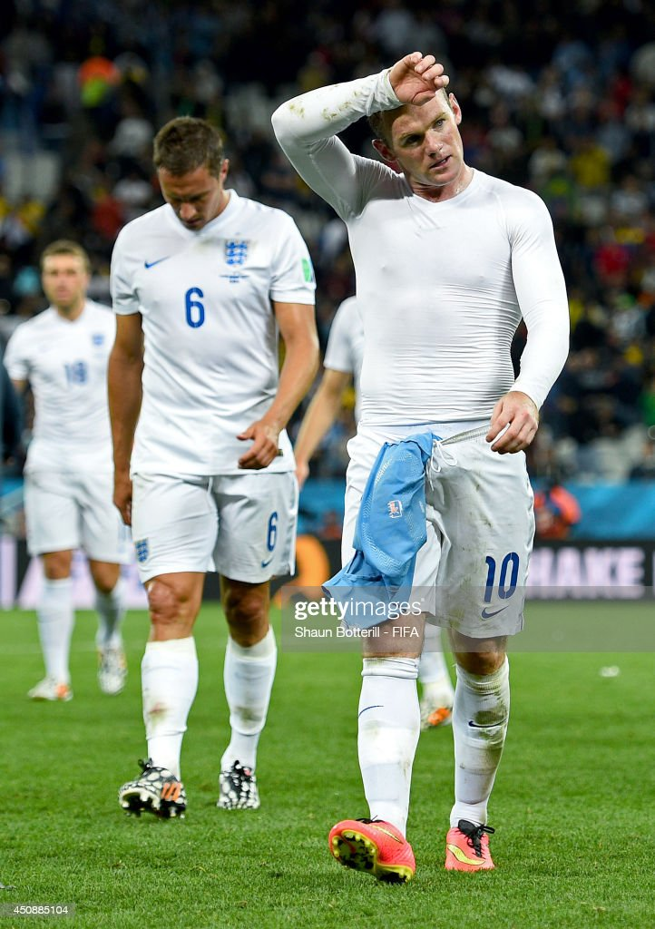 Wayne Rooney of England looks dejected after 2-1 defeat by Uruguay in the 2014 FIFA World Cup Brazil Group D match between Uruguay and England at Arena de Sao Paulo on June 19, 2014 in Sao Paulo, Brazil.