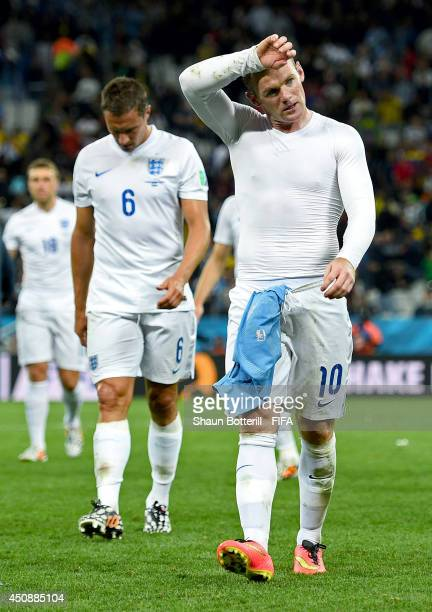 Wayne Rooney of England looks dejected after 21 defeat by Uruguay in the 2014 FIFA World Cup Brazil Group D match between Uruguay and England at...