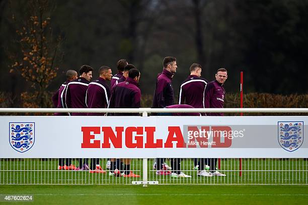 Wayne Rooney of England looks on as he trains with team mates behind the boards during an England training session ahead of the Euro 2016 qualifier...