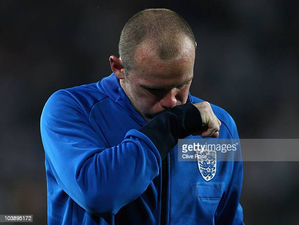 Wayne Rooney of England looks on at the end of the UEFA EURO 2012 Group G Qualifier between Switzerland and England at St Jakob Park on September 7...