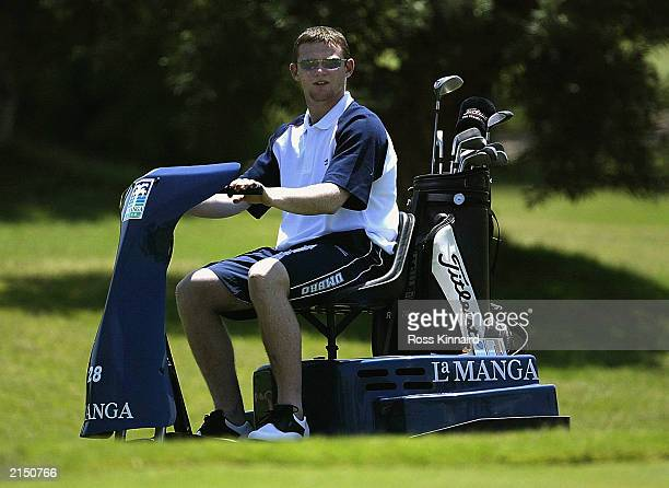 Wayne Rooney of England on a golf buggy during a round of golf on May 25, 2003 on the North Course at the La Manga resort in La Manga, Spain.