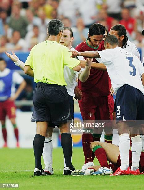 Wayne Rooney of England pleads with Referee Horacio Elizondo of Argentina during the FIFA World Cup Germany 2006 Quarterfinal match between England...