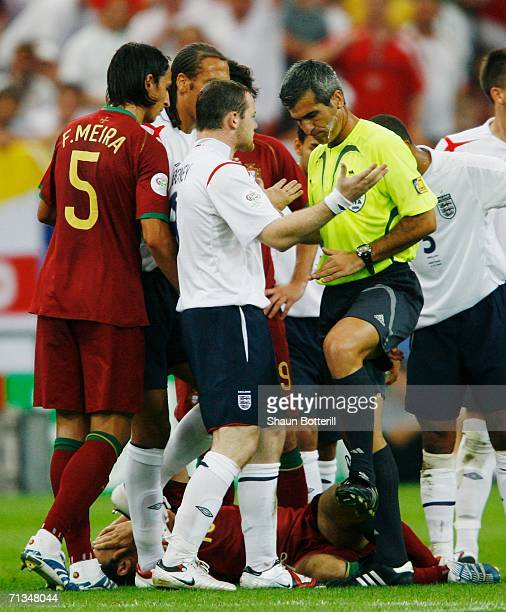 Wayne Rooney of England pleads with Referee Horacio Elizondo of Argentina prior to being sent off during the FIFA World Cup Germany 2006 Quarterfinal...