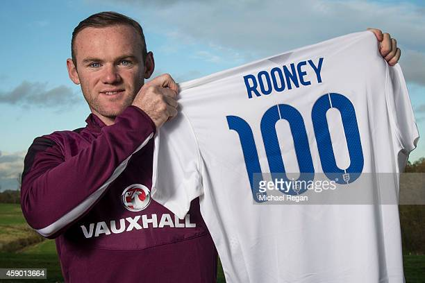 Wayne Rooney of England poses with a shirt to celebrate him winning his 100th international cap which he hopes to gain by playing in the EURO 2016...