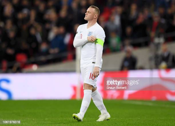 Wayne Rooney of England puts the England arm band on as he walks onto the pitch during the International Friendly match between England and United...