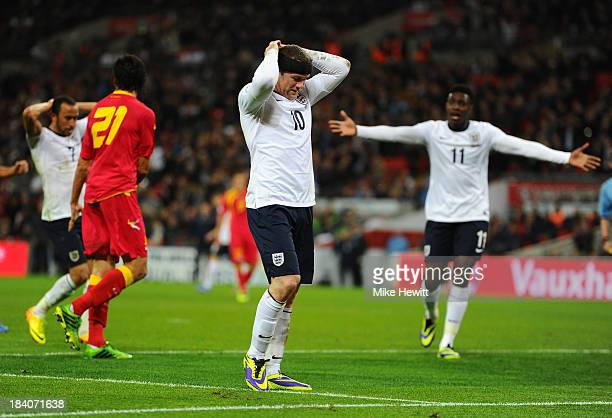 Wayne Rooney of England reacts after missing a chance at goal during the FIFA 2014 World Cup Qualifying Group H match between England and Montenegro...