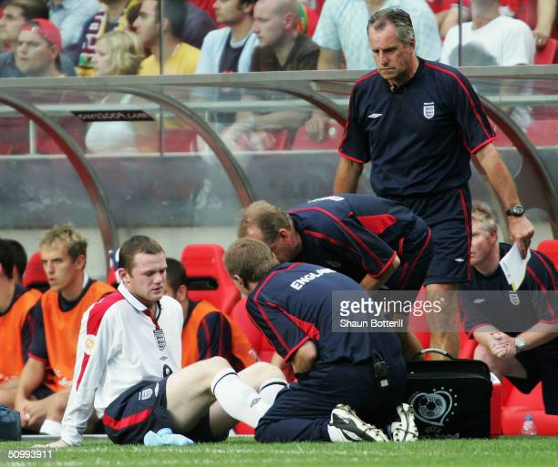 Wayne Rooney of England receives treatment during the UEFA Euro 2004 Quarter Final match between Portugal and England at the Luz Stadium on June 24...