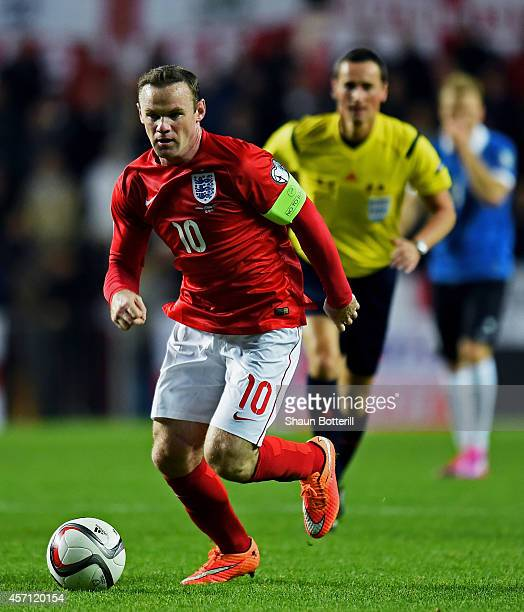 Wayne Rooney of England runs with the ball during the EURO 2016 Qualifier match between Estonia and England at A Le Coq Arena on October 12 2014 in...