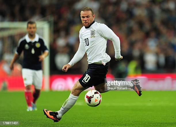 Wayne Rooney of England runs with the ball during the International Friendly match between England and Scotland at Wembley Stadium on August 14 2013...