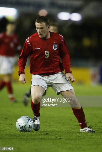 Wayne Rooney of England runs with the ball during the International Friendly match between Sweden and England held on March 31, 2004 at Ullevi...