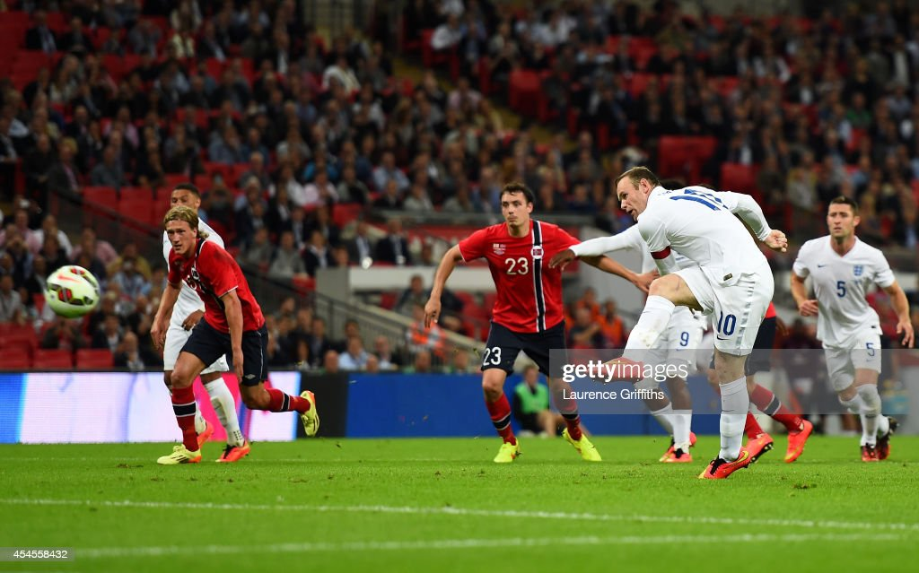 Wayne Rooney of England scores a goal from the penalty spot during the International friendly match between England and Norway at Wembley Stadium on September 3, 2014 in London, England.