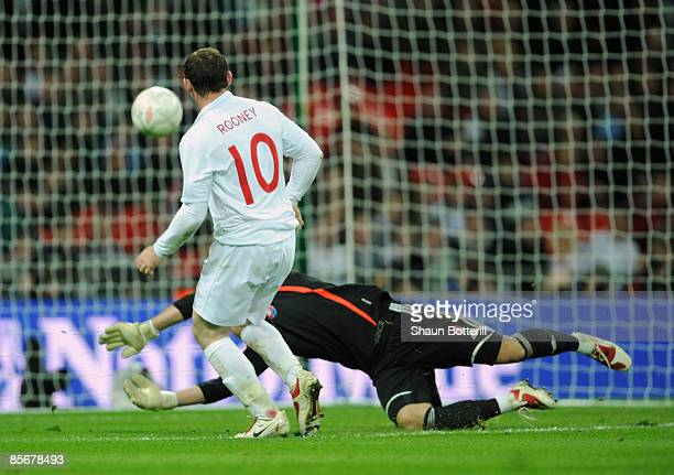 Wayne Rooney of England scores during the International Friendly match between England and Slovakia at Wembley Stadium on March 28 2009 in London...