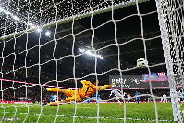 Wayne Rooney of England scores Englands first and equalising goal from a penalty during the EURO 2016 Qualifier Group E match between England and...