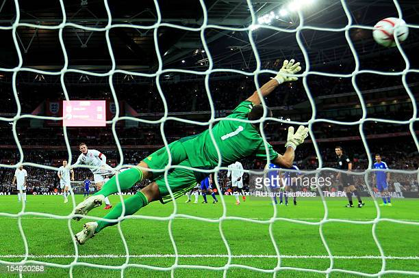 Wayne Rooney of England scores from the penalty spot during the FIFA 2014 World Cup Group H qualifying match between England and San Marino at...