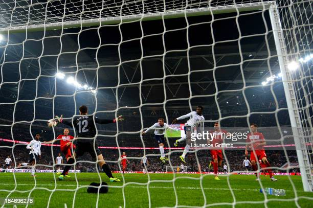 Wayne Rooney of England scores his team's opening goal with a header past Wojciech Szczesny of Poland during the FIFA 2014 World Cup Qualifying Group...