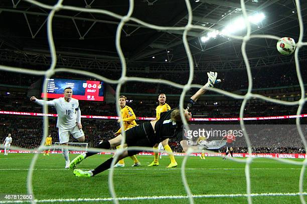 Wayne Rooney of England scores the first goal during the EURO 2016 Qualifier match between England and Lithuania at Wembley Stadium on March 27 2015...