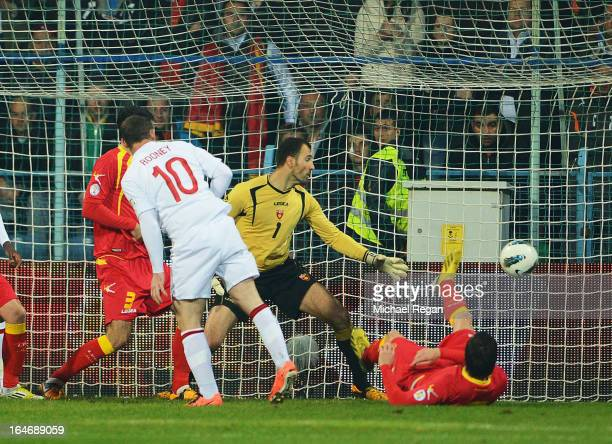 Wayne Rooney of England scores the opening goal during the FIFA 2014 World Cup Qualifier Group H match between Montenegro and England at City Stadium...