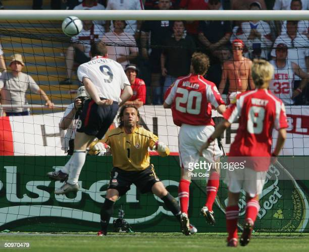 Wayne Rooney of England scores their first goal during the UEFA Euro 2004 Group B match between England and Switzerland at the Estadio Cidade de...