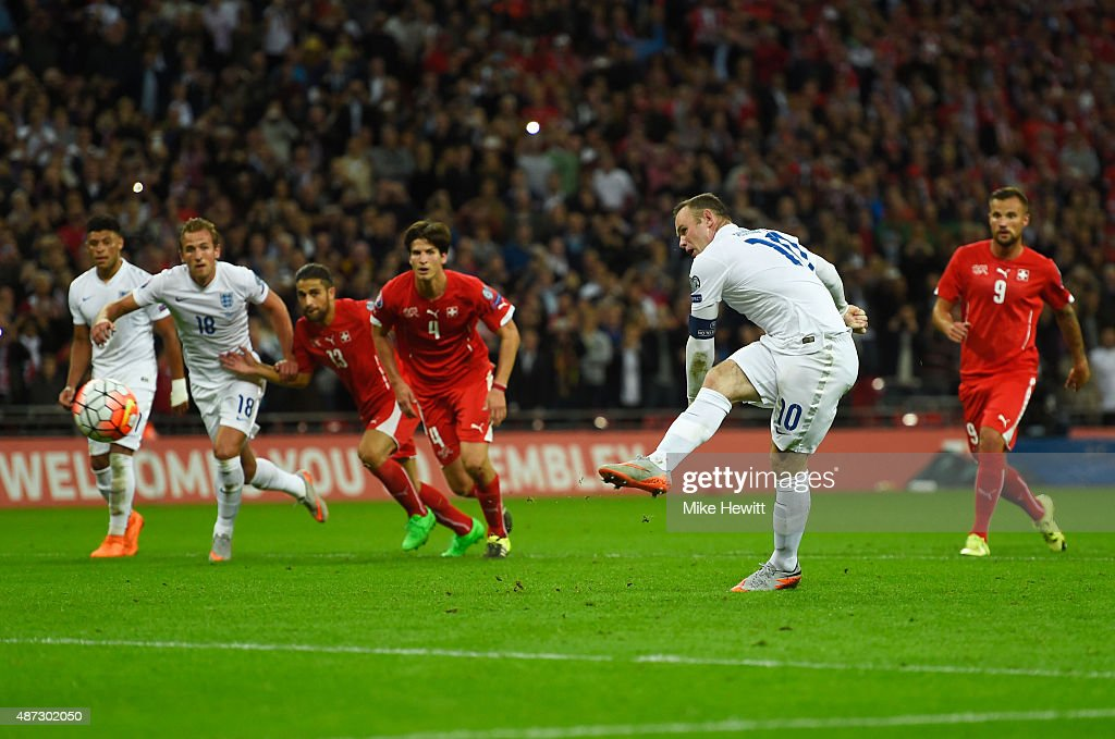 Wayne Rooney of England scores their second goal from the penalty spot during the UEFA EURO 2016 Group E qualifying match between England and Switzerland at Wembley Stadium on September 8, 2015 in London, United Kingdom. Wayne Rooney's 50th goal breaks the record for most international goals scored for England. Sir Bobby Charlton held the record previously with 49 goals.