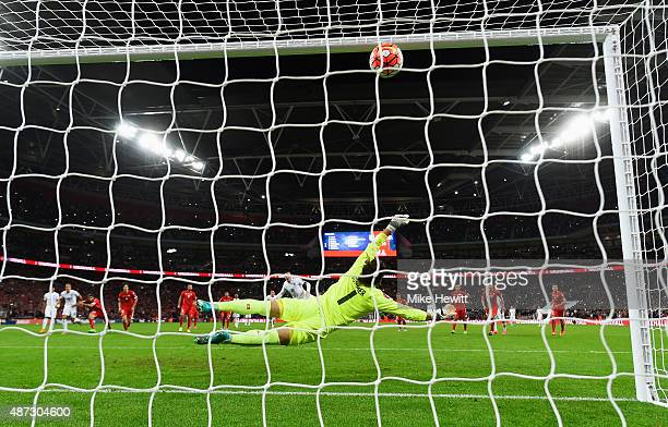 Wayne Rooney of England scores their second goal from the penalty spot during the UEFA EURO 2016 Group E qualifying match between England and...