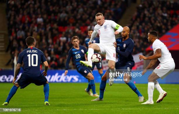 Wayne Rooney of England shoots as he challenged by John Brooks of the United States during the International Friendly match between England and...