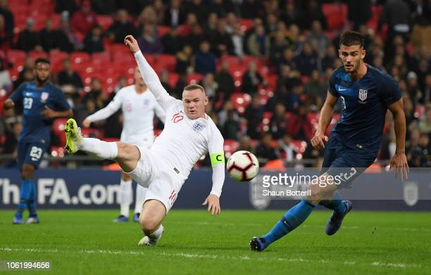 Wayne Rooney of England shoots while under pressure from Matthew Miazga of the United States during the International Friendly match between England...