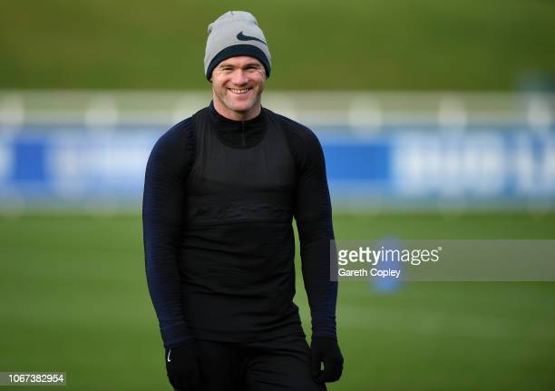 Wayne Rooney of England smiles during a training session at St Georges Park on November 14 2018 in BurtonuponTrent England