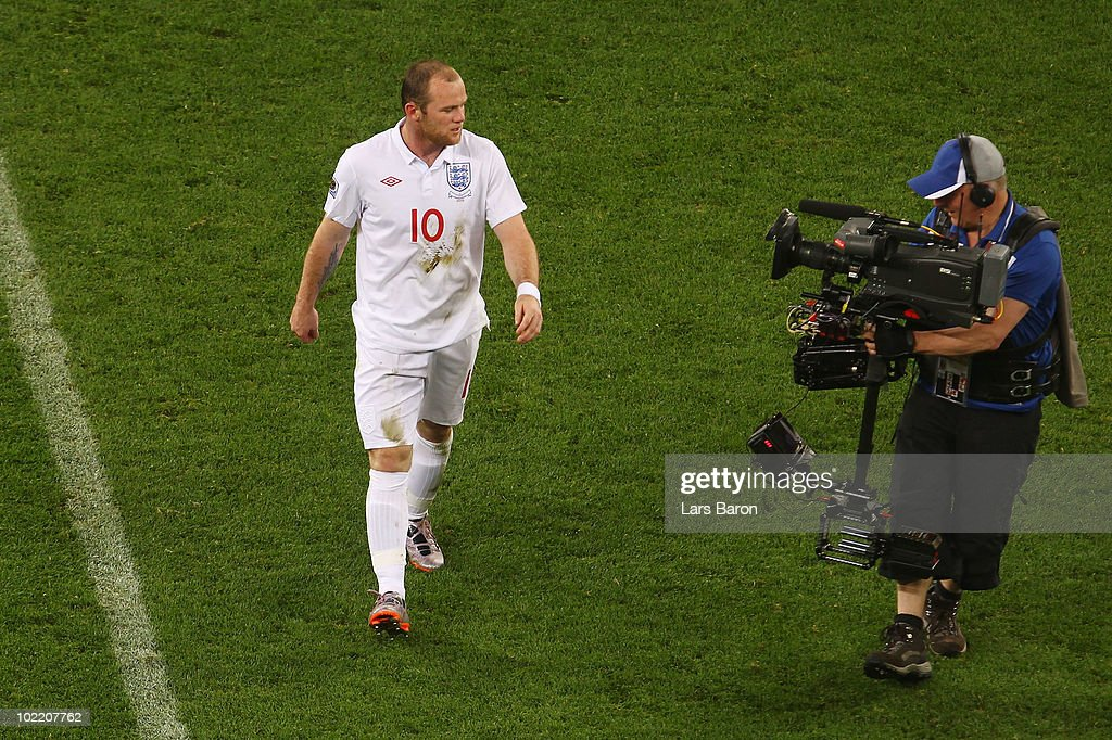 Wayne Rooney of England speaks into the camera as he walks off the pitch dejected after the 2010 FIFA World Cup South Africa Group C match between England and Algeria at Green Point Stadium on June 18, 2010 in Cape Town, South Africa.