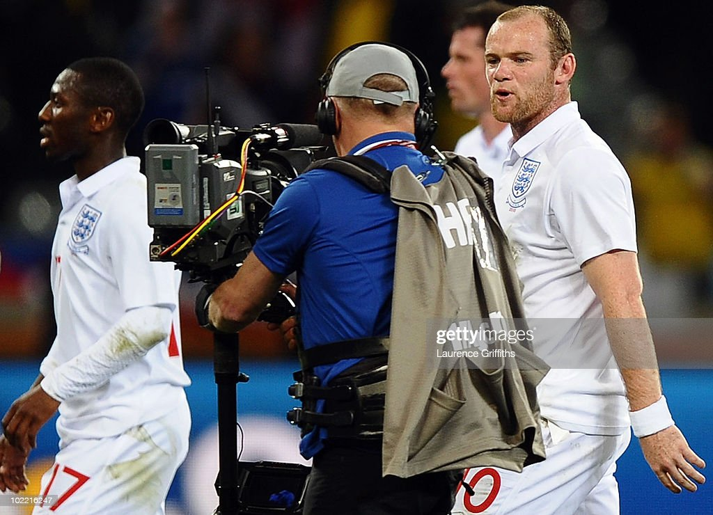 Wayne Rooney of England speaks to a cameraman as he walks off the pitch dejected after the 2010 FIFA World Cup South Africa Group C match between England and Algeria at Green Point Stadium on June 18, 2010 in Cape Town, South Africa.