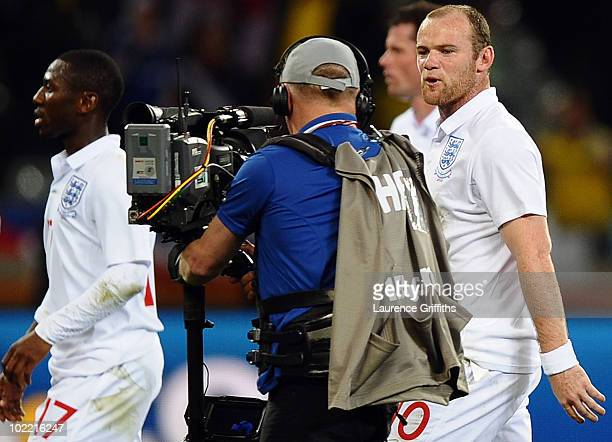 Wayne Rooney of England speaks to a cameraman as he walks off the pitch dejected after the 2010 FIFA World Cup South Africa Group C match between...
