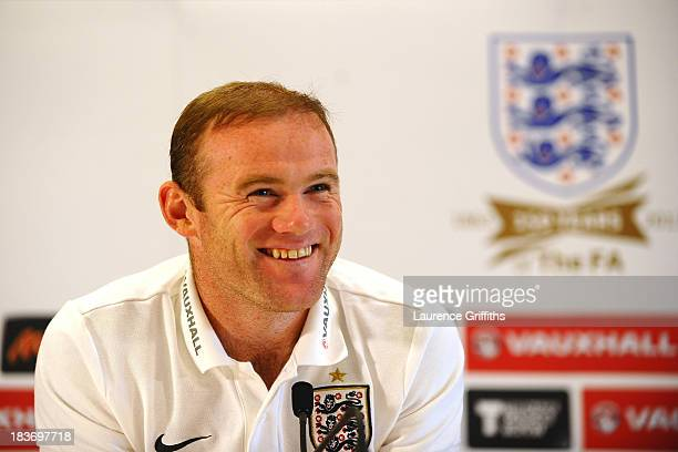 Wayne Rooney of England speaks to the media during a press conference at St Georges Park on October 8, 2013 in Burton-upon-Trent, England.