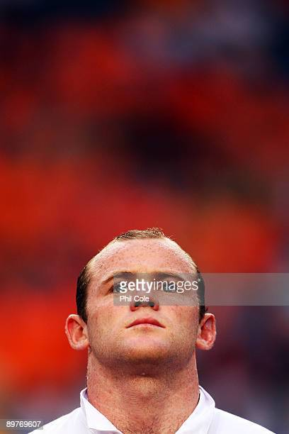 Wayne Rooney of England stands for the national anthem prior to the International Friendly between Netherlands and England at the Amsterdam Arena on...