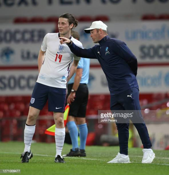 Wayne Rooney of England talks to James Bay during the Soccer Aid for Unicef 2020 match between England and Rest of the World at Old Trafford on...