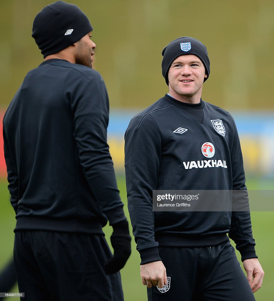 Wayne Rooney of England talks with Joleon Lescott during a training session at St Georges Park on March 19, 2013 in Burton-upon-Trent, England.