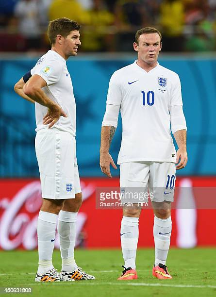 Wayne Rooney of England talks with Steven Gerrard of England during the 2014 FIFA World Cup Brazil Group D match between England and Italy at Arena...