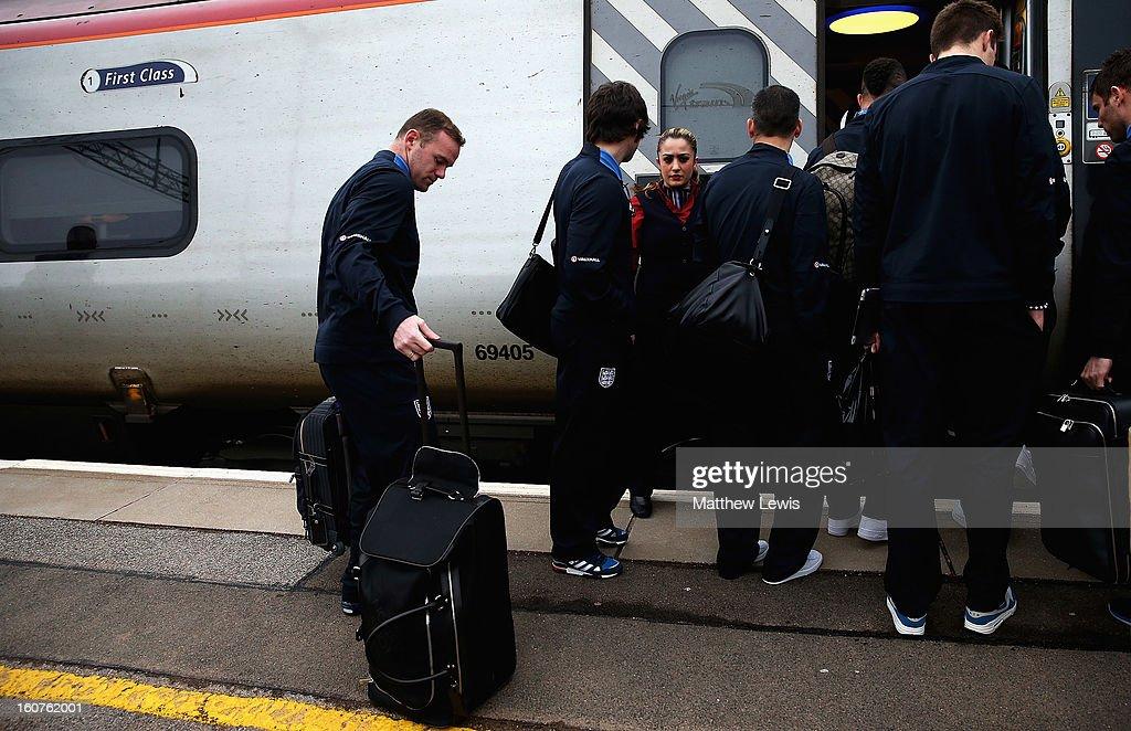 Wayne Rooney of England travels to London by Train from Birmingham International Train Station on February 5, 2013 in Birmingham, England.
