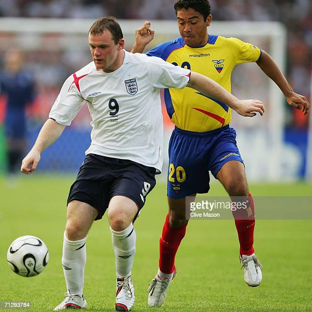 Wayne Rooney of England tussles for posession with Edwin Tenorio of Ecuador during the FIFA World Cup Germany 2006 Round of 16 match between England...