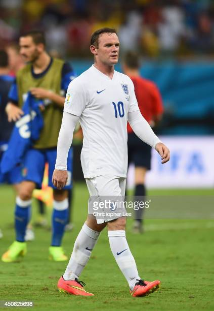 Wayne Rooney of England walks off the field after being defeated by Italy 21 during the 2014 FIFA World Cup Brazil Group D match between England and...