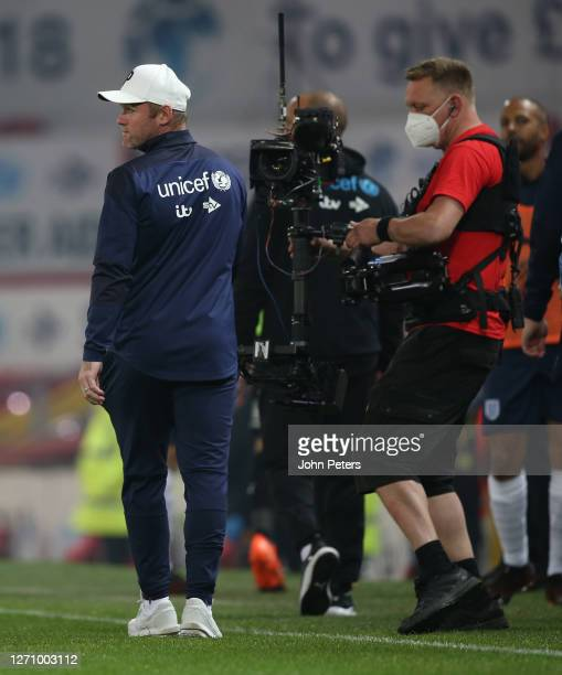 Wayne Rooney of England walks out for the second half during the Soccer Aid for Unicef 2020 match between England and Rest of the World at Old...
