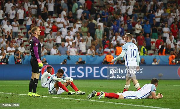 Wayne Rooney of England walks toward Dele Alli to console after the UEFA EURO 2016 round of 16 match between England and Iceland at Allianz Riviera...