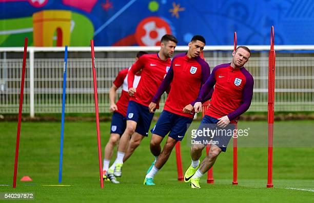 Wayne Rooney of England warms up during a training session at Stade du Bourgognes ahead of the UEFA Euro 2016 match against Wales on June 15 2016 in...