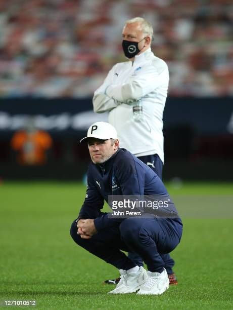 Wayne Rooney of England watches during the penalty shoot out during the Soccer Aid for Unicef 2020 match between England and Rest of the World at Old...