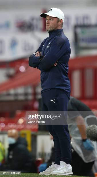 Wayne Rooney of England watches from the touchline during the Soccer Aid for Unicef 2020 match between England and Rest of the World at Old Trafford...