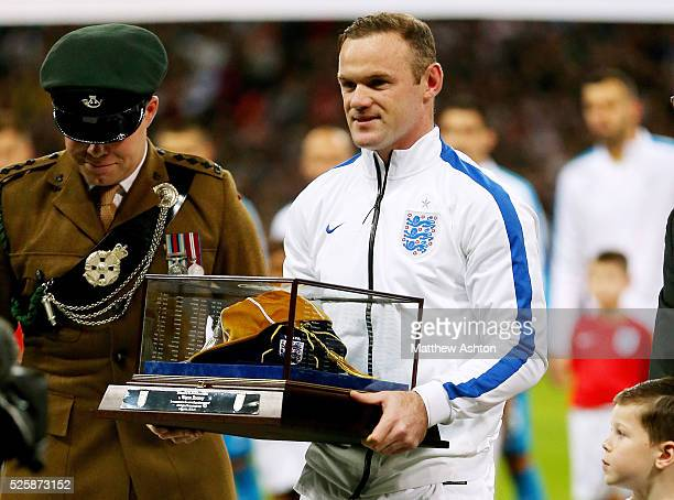 Wayne Rooney of England with his cap for 100 appearances