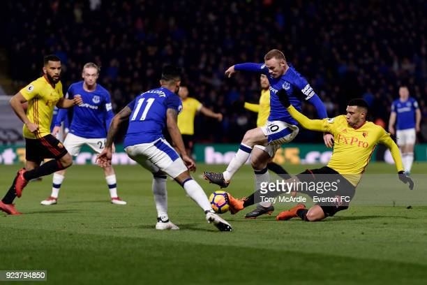 Wayne Rooney of Everton and Etienne Capoue challenge for the ball during the Premier League match between Watford and Everton at Vicarage Road on...