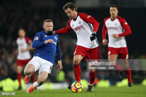 Wayne Rooney of Everton and Grzegorz Krychowiak of West Bromwich Albion broken leg during the Premier League match between Everton and West Bromwich...