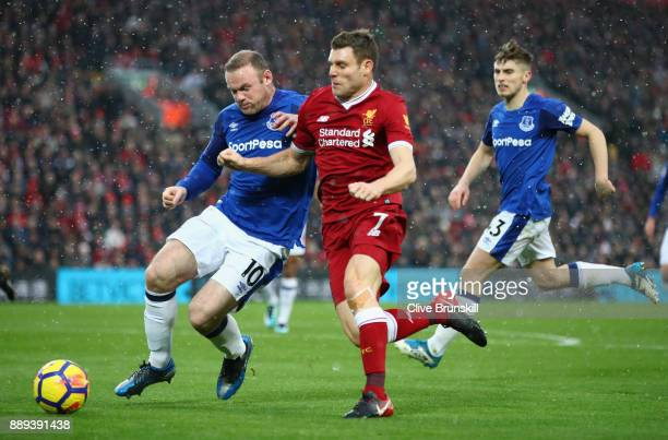 Wayne Rooney of Everton and James Milner of Liverpool battle for the ball during the Premier League match between Liverpool and Everton at Anfield on...