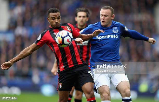 Wayne Rooney of Everton and Junior Stanislas of AFC Bournemouth compete for the ball during the Premier League match between Everton and AFC...