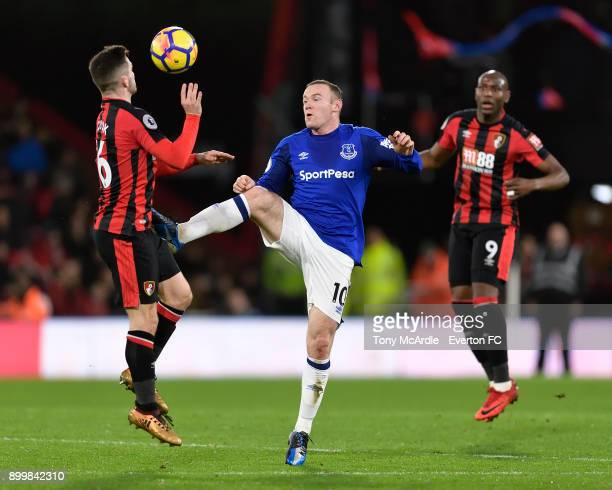 Wayne Rooney of Everton and Lewis Cook challenge for the ball during the Premier League match between AFC Bournemouth and Everton at the Vitality...