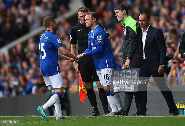 Wayne Rooney of Everton and Manchester United about to run on to the pitch as he replaces Tom Cleverley of Everton during the Duncan Ferguson...